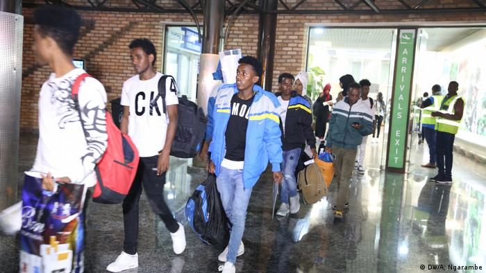 Refugees arriving at Kigali airport in October