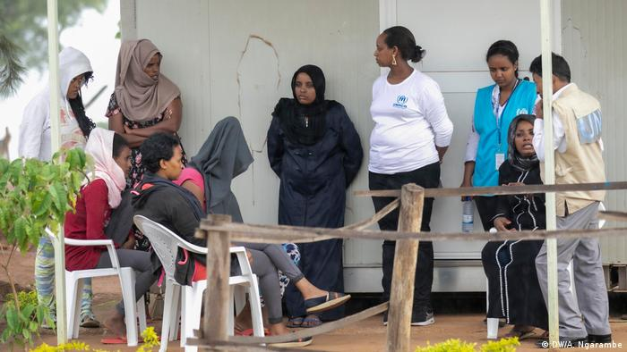 Refugees listening to UNHCR officials