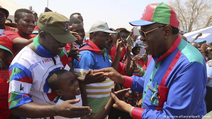 Namibian President Hage Geingob, right, greets supporters at an election rally in Grootfontein, Namibia