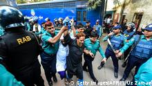27.11.2019 *** Police escort detainees (C) accused of allegedly plotting the Holey Artisan Bakery cafe attack, carried out by Islamist militants, to a courtroom for their trial in Dhaka on November 27, 2019. - Five young men armed with guns and knives stormed the cafe on July 1, 2016 taking dozens hostage and killing 22 people. (Photo by Munir UZ ZAMAN / AFP) (Photo by MUNIR UZ ZAMAN/AFP via Getty Images)