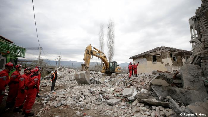 Rescuers search through rubble following earthquake in Durres