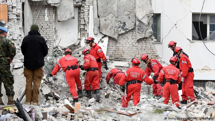 Rescue workers search for survivors (Getty Images/AFP/G. Shkullaku)