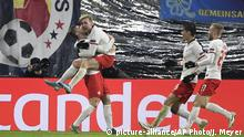 Leipzig's Emil Forsberg, second from left, celebrates with teammates after scoring his side's second goal during the Champions League group G soccer match between RB Leipzig and Benfica in Leipzig, Germany, Wednesday, Nov. 27, 2019. (AP Photo/Jens Meyer)  
