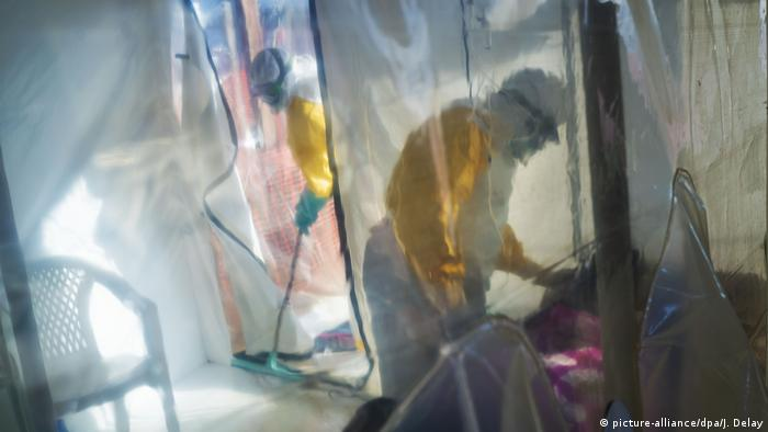 Health workers treat an Ebola patient in an isolation ward in the Congolese city of Beni