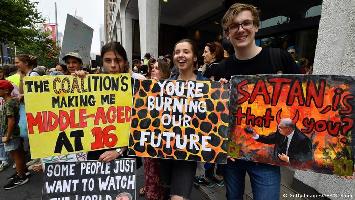Students hold placards during a rally calling for action on climate change