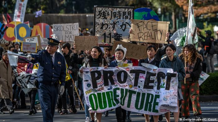 Protesters hold placards as they take part in a Global Climate Strike protest on November 29, 2019 in Tokyo (Getty Images/C. Court)