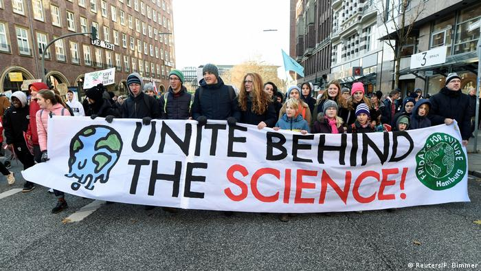 Protesters hold a banner during the Global Climate Strike of the movement Fridays for Future, in Hamburg