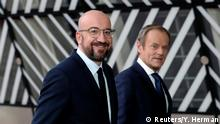 Incoming European Council President Charles Michel is welcomed by outgoing European Council President Donald Tusk during a handover ceremony in Brussels, Belgium November 29, 2019. REUTERS/Yves Herman