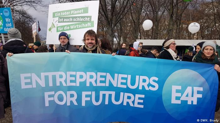Entrepreneur demonstrating at global climate strike in Berlin (DW/T.Walther)