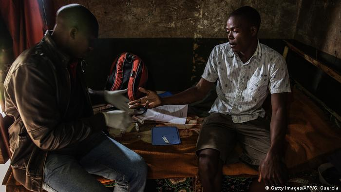 A health worker tests someone for HIV inside their home