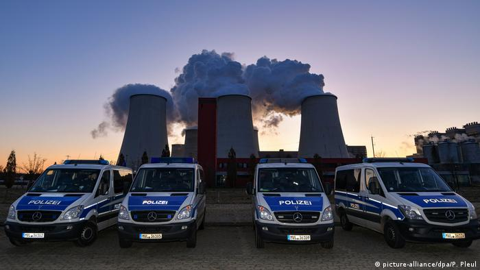 Police cars are parked outside of the Jänschwalde mine