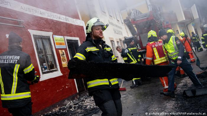 Firefighters clean up after the Hallstatt blaze
