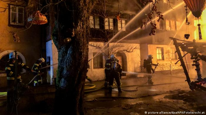 Firefighters attempt to extinguish a blaze in Hallstatt