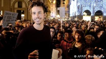 'Sardines' co-founder Mattia Santori stands in front of a group of people protesting far-right populism in Italy (AFP/F. Monteforte)