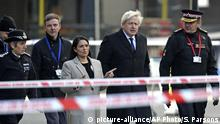 Britain's Prime Minister Boris Johnson, second right, Home Secretary Priti Patel, center, and Metropolitan Police Commissioner, Cressida Dick, left, attend the scene in central London, Saturday, Nov. 30, 2019, after an attack on London Bridge on Friday. UK counterterrorism police on Saturday searched for clues into how a man imprisoned for terrorism offenses before his release last year managed to stab several people before being tackled by bystanders and shot dead by officers on London Bridge. Two people were killed and three wounded. (Steve Parsons/PA via AP) |