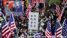 Protesters hold banners and American flags during a rally outside the U.S. Consulate in Hong Kong, Sunday, Dec. 1, 2019. Pro-democracy protesters renewed pressure on the Hong Kong government Sunday with three separate marches, appealing to President Donald Trump for help and demanding that police stop using tear gas. The banner at center reads Kick out communist, return Hong Kong. (AP Photo/Ng Han Guan) |
