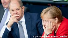 Olaf Scholz and Angela Merkel (picture-alliance/dpa/K. Nietfeld)