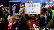 01.12.2019 WARSAW, POLAND - DECEMBER 01: Protesters hold banners as they demonstrate in solidarity with Polish judges in front of the Ministry of Justice on December 1, 2019 in Warsaw, Poland. The government recently introduced a new disciplinary regime for judges that allows them to be investigated for the content of their decisions, a policy which protesters regard as further erosion of judicial independence. In late November, Polands parliament also elected three controversial nominees as judges to the constitutional tribunal, including two former Law and Justice (PiS) Party lawmakers. (Photo by Omar Marques/Getty Images)