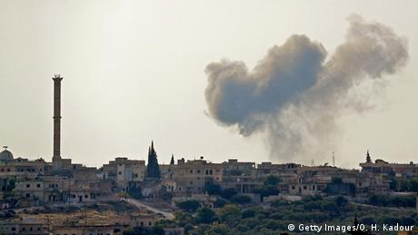 Smoke blows over the village of Bsaqla during reported strikes by Syrian pro-regime forces. Omar HAJ KADOUR / AFP.
