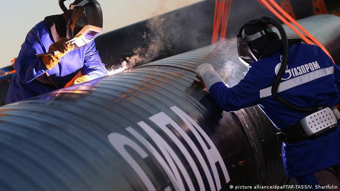 Gazprom staff working on a section of the Power of Siberia gas pipeline