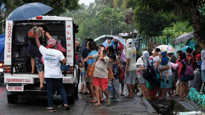 Residents evacuate their area in preparation for the coming of Typhoon Kammuri in Legazpi, Albay province, southeast of Manila.