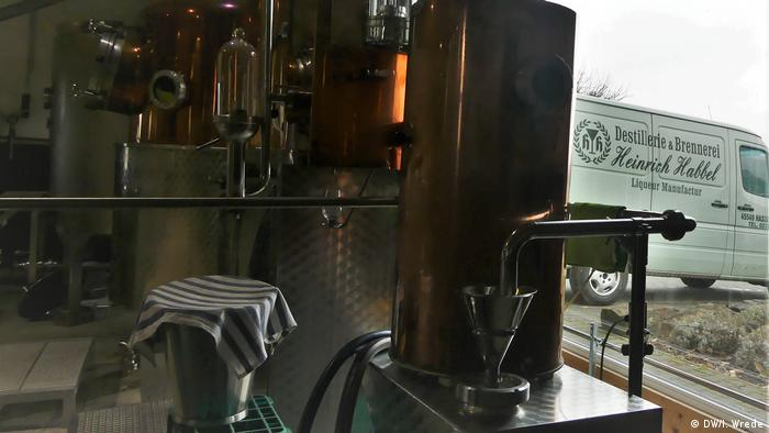 Distillery equipment with a company van outside