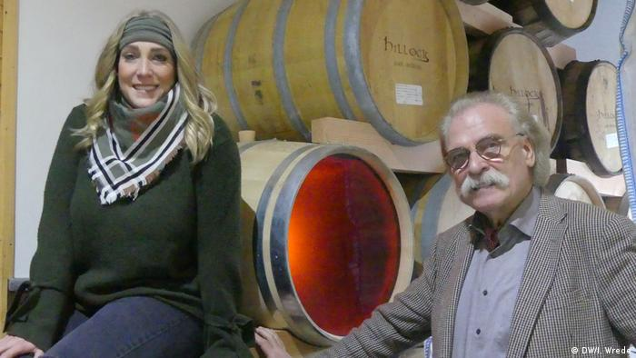 Michaela and Michael Habbel in front of whisky casks (DW/I. Wrede)