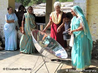 Villagers in India learn to use a parabolic cooker