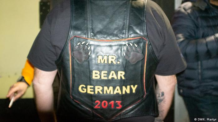 A bear wearing leather
