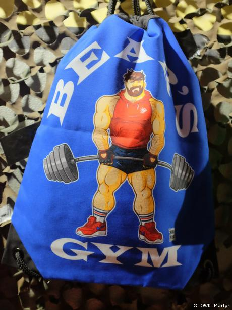 A bag with a bear on it lifting weights