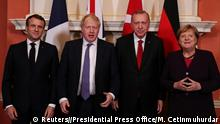France's President Emmanuel Macron, Britain's Prime Minister Boris Johnson, Turkish President Tayyip Erdogan and German Chancellor Angela Merkel pose as they meet at Downing Street ahead of the NATO summit in London, Britain, December 3, 2019. Murat Cetinmuhurdar/Presidential Press Office/Handout via REUTERS THIS IMAGE HAS BEEN SUPPLIED BY A THIRD PARTY.