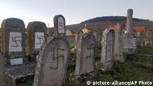 Tombs tagged with swastikasthe are pictured in Jewish cemetery in Westhoffen, eastern France, Tuesday, Dec.3, 2019. Regional authorities say 107 tombs of the Jewish cemetery of Westhoffen have been vandalized. (AP Photo) |