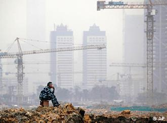 A worker rests on a construction site of a real estate project in Guangzhou, in south China's Guangdong province, Wednesday, Jan. 20, 2010. China's economic growth accelerated to 10.7 percent in the final quarter of 2009, adding to pressure on Beijing to cool inflation pressures while keeping the country's recovery on track. (AP Photo) ** CHINA OUT **
