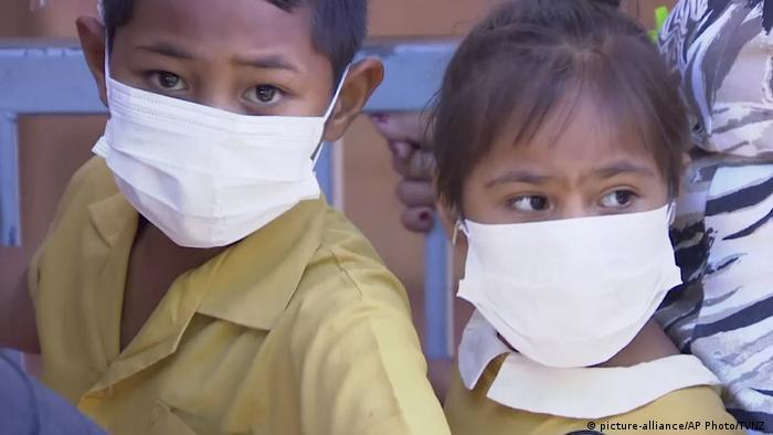 Samoan children with face masks