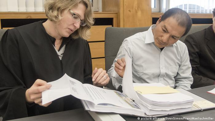 A lawyer goes through paperwork with her client