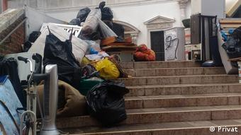 Large trashed objects sit on a public stairway in Venice