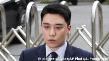 Seungri, a former member of the popular K-pop boy band Big Bang, speaks upon his arrival at the Seoul Metropolitan Police Agency's Intelligence Criminal Investigation Squad in Seoul, South Korea, Wednesday, Aug. 28, 2019. Police on Wednesday summoned Seungri on charges of gambling in a foreign country and securing gambling money in violation of the country's Foreign Exchange Transaction Act, Yonhap news agency reported. (AP Photo/Ahn Young-joon)  