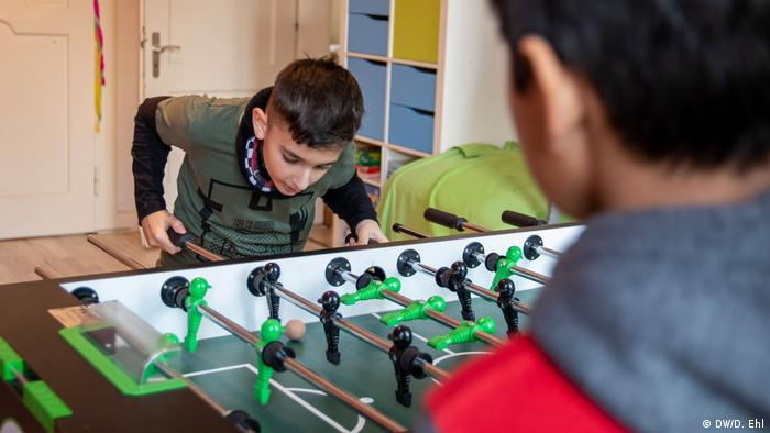 Children play foosball