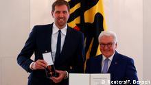 Retired Dallas Mavericks basketball star Dirk Nowitzki receives the Order of Merit of the Federal Republic of Germany from President Frank Walter Steinmeier in Berlin, Germany, December 4, 2019. REUTERS/Fabrizio Bensch