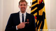Retired Dallas Mavericks basketball star Dirk Nowitzki poses for the media after he received the Order of Merit of the Federal Republic of Germany from President Frank Walter Steinmeier in Berlin, Germany, December 4, 2019. REUTERS/Fabrizio Bensch