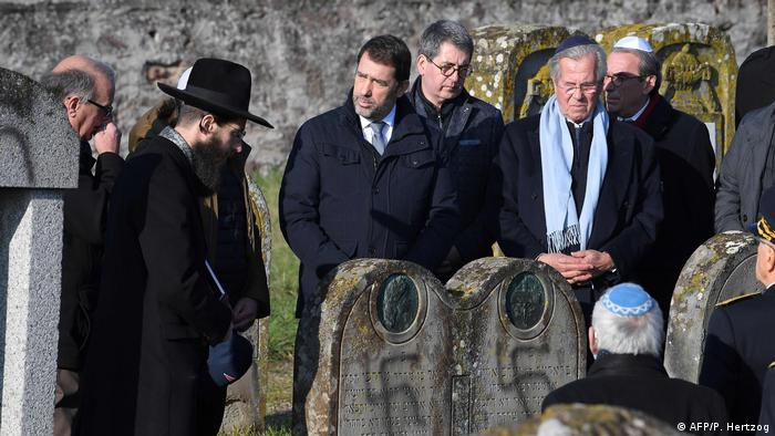 Картинки по запросу Dozens of Jewish gravestones daubed with swastikas in eastern France