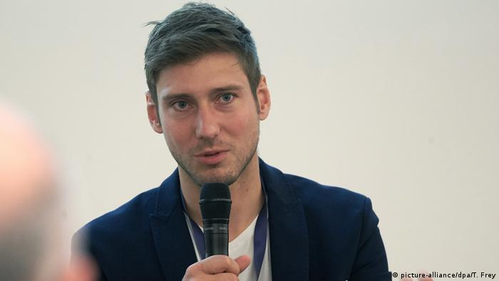 German fencer Max Hartung speaks with a microphone