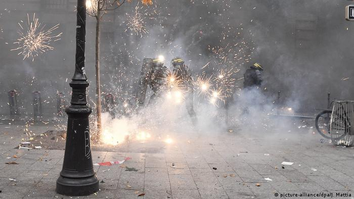 Fireworks throw by protesters erupt around police in Paris