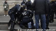 Riot police officers detain a protester during a demonstration in Paris, Thursday, Dec. 5, 2019. Small groups of protesters are smashing store windows, setting fires and hurling flares in eastern Paris amid mass strikes over the government's retirement reform. (AP Photo/Rafael Yaghobzadeh) |