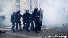 French CRS riot police stand amidst tear gas during clashes at a demonstration against French government's pensions reform plans in Paris as part of a day of national strike and protests in France, December 5, 2019. REUTERS/Gonzalo Fuentes