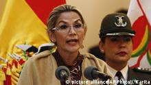 Bolivia's interim President Jeanine Anez speak before delivering the document that accredits Salvador Romero as the new member of the Supreme Electoral Tribunal, at the presidential palace, in La Paz, Bolivia, Monday, Nov. 25, 2019. Bolivia is struggling to stabilize after weeks of anti-government protests and violence in which at least 30 people have been killed. Former president Evo Morales resigned on Nov. 10 after an election that the opposition said was rigged. (AP Photo/Juan Karita) |