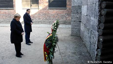 olish Prime Minister Mateusz Morawiecki and German Chancellor Angela Merkel attend a wreath-laying ceremony at the Auschwitz-Birkenau (Reuters/A. Gazeta)