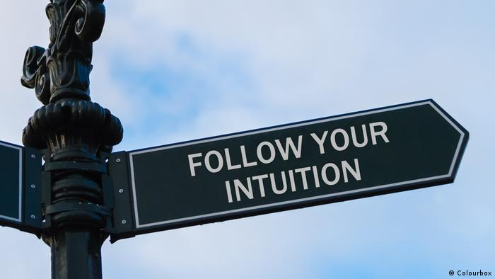 stret sign that reads: follow your intuition (Colourbox)