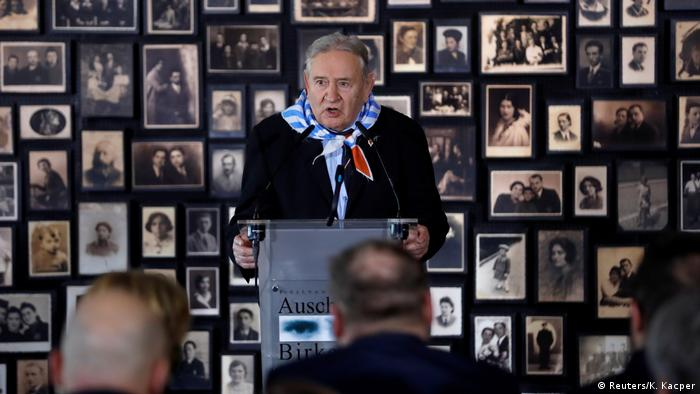 Bogdan Bartnikowski speaks in the building of the so-called Sauna during German Chancellor Angela Merkel and Polish Prime Minister Mateusz Morawiecki's visit at the former Nazi German concentration and extermination camp Auschwitz-Birkenau