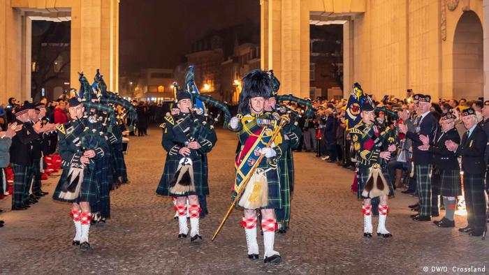A Scottish military band passes through the Menin Gate in Ypres, Belgium